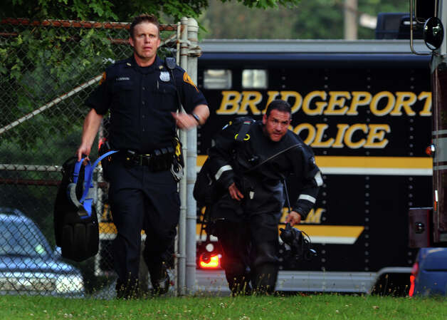Members of the Bridgeport Police SCUBA Team respond to a report of a drowning at Lake Mohegan Beach in Fairfield, Conn. on Tuesday July 17, 2012. Photo: Christian Abraham / Connecticut Post
