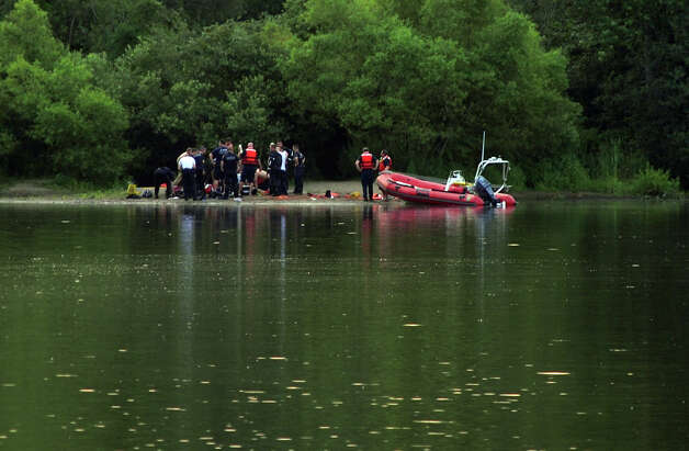 Scenes of rescue crews at a reported drowning at Lake Mohegan Beach in Fairfield, Conn. on Tuesday July 17, 2012. Photo: Christian Abraham / Connecticut Post