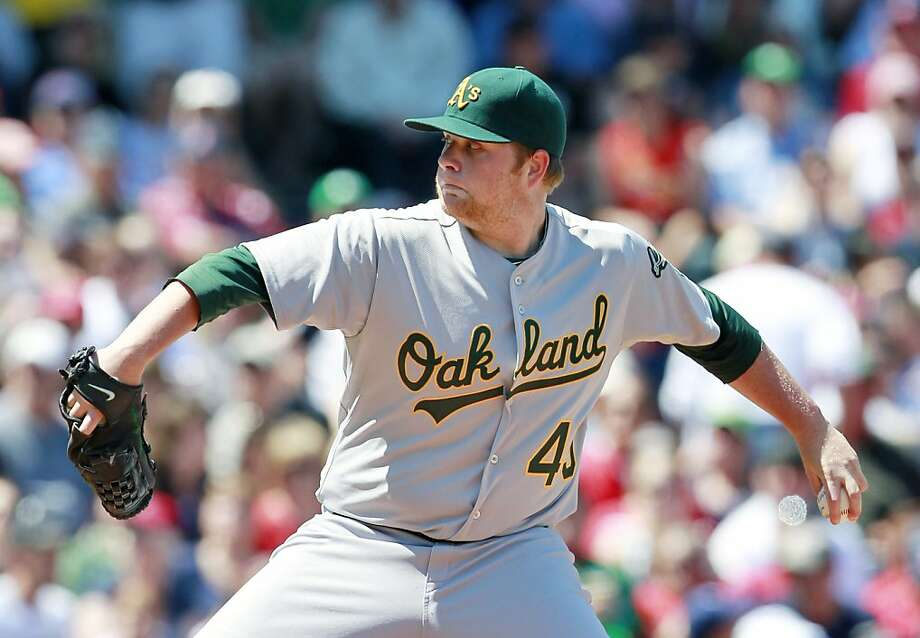 Oakland Athletics' Brett Anderson pitches against the Boston Red Sox in the second inning of a baseball game, Sunday, June 5, 2011, in Boston. Photo: Michael Dwyer, AP