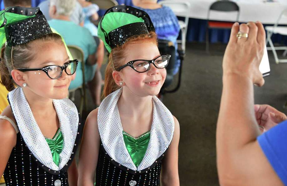 Adrianna Murray, 7, of Saratoga Springs and Grace Bellinger, 8, of Rock City Falls pose for a picture as they wait to go on at the talent show at the 171st Saratoga County Fair in Ballston Spa Tuesday July 17, 2012.   (John Carl D'Annibale / Times Union) Photo: John Carl D'Annibale / 00018353A