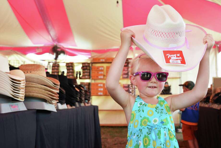 Four-year-old Tammy Marcotte of Corinth tries on a cowboy hat  at the 171st Saratoga County Fair in Ballston Spa Tuesday July 17, 2012.   (John Carl D'Annibale / Times Union) Photo: John Carl D'Annibale / 00018353A