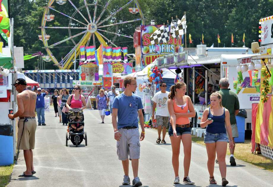 Fair goers on the midway at the 171st Saratoga County Fair in Ballston Spa Tuesday July 17, 2012.   (John Carl D'Annibale / Times Union) Photo: John Carl D'Annibale / 00018353A