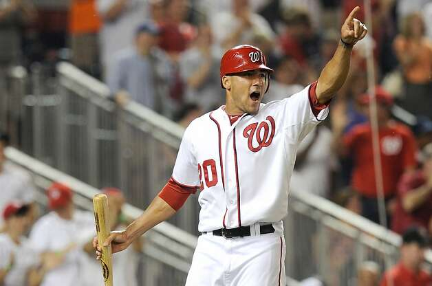 WASHINGTON, DC - JULY 17:  Ian Desmond #20 of the Washington Nationals celebrates after scoring the tying run in the ninth inning against the New York Mets at Nationals Park on July 17, 2012 in Washington, DC. Washington won the game 5-4 in ten innings. (Photo by Greg Fiume/Getty Images) Photo: Greg Fiume, Getty Images