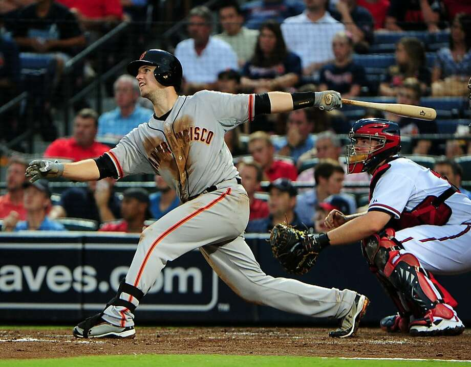 ATLANTA, GA - JULY 17: Buster Posey #28 of the San Francisco Giants doubles to knock in three runs against the Atlanta Braves at Turner Field on July 17, 2012 in Atlanta, Georgia. (Photo by Scott Cunningham/Getty Images) Photo: Scott Cunningham, Getty Images
