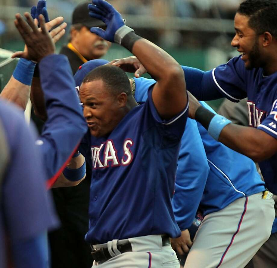 Texas Rangers Adrian Beltre is greeted by his teammates after hitting a solo home run on the fourth inning of their MLB baseball game against the  Oakland Athletics in Oakland Calif., Tuesday, July 17, 2012. Photo: Lance Iversen, The Chronicle