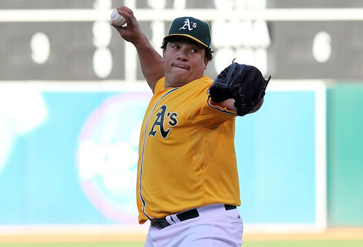 Oakland Athletics starting pitcher Bartolo Colon throws to the Texas Rangers during the first inning of their MLB baseball game in Oakland Calif., Tuesday, July 17, 2012.