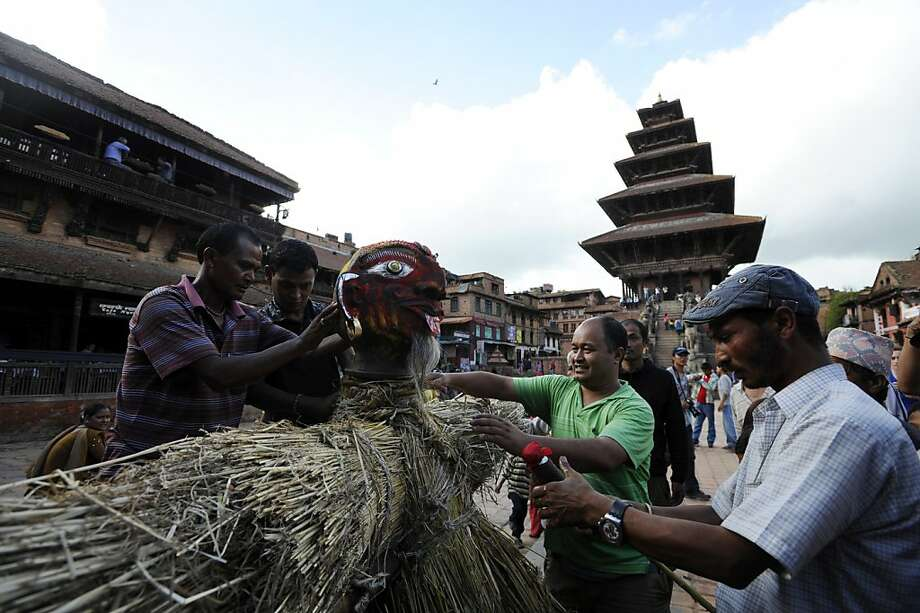 "Nepalese people makes a straw effigy of Ghanta Karna to burn during celebrations of the Hindu festival of ""Gathemangal"", also known as Ghanta Karna, in Bhaktapur on the outskirts of Kathmandu on July 17, 2012. The Nepalese festival, which celebrates the defeat of the mythical demon Ghanta Karna (""bell-ears""), is celebrated by performing the legendary drama in the streets. AFP PHOTO/ Prakash MATHEMAPRAKASH MATHEMA/AFP/GettyImages Photo: Prakash Mathema, AFP/Getty Images"