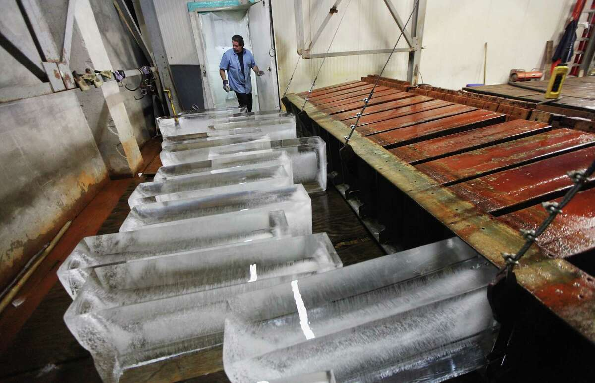 NEW YORK, NY - JULY 17: Ricky Perez unloads 300-pound blocks of ice from a brine tank to be sold at Arctic Glacier Premium Ice on July 17, 2012 in the Bronx borough of New York City. Perez said,