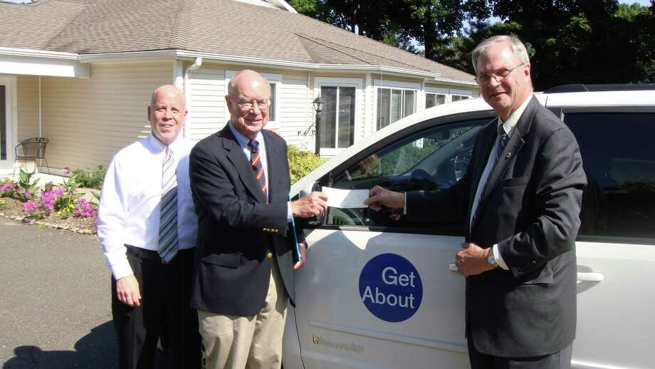 David Van Buskirk, First County Bank Business Development officer, presents Getabout board member Paul Stein with a $7,500 grant while branch manager Michael Victor looks on. July 12, 2012, New Canaan, Conn. Photo: Contributed Photo