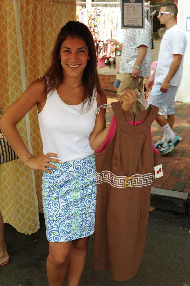 Martina Berg, 19, shows off some of Skirtin' Around's store inventory at the annual Village Fair and Sidewalk Sale, July 14, 2012, in New Canaan, Conn. Photo by Harrison Thompson Photo: Contributed Photo