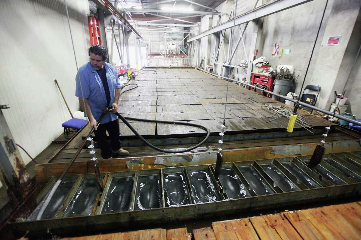 NEW YORK, NY - JULY 17: Ricky Perez prepares to unload 300-pound blocks of ice from a brine tank to be sold at Arctic Glacier Premium Ice on July 17, 2012 in the Bronx borough of New York City. Perez said,