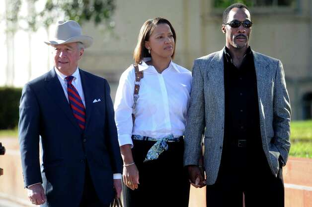 Attorney Dick DeGuerin, Stacy Walker, and Calvin Walker leave the Jack Brooks Federal Building after attending potential juror questioning for Calvin Walker's 37-count federal indictment in Beaumont, Wednesday, November 30, 2011. Tammy McKinley/The Enterprise Photo: TAMMY MCKINLEY