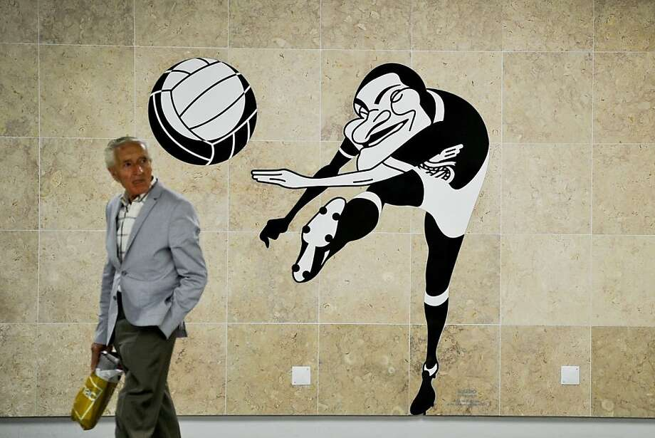 Up for a header? A man walks past a street art caricature of Portuguese football player Eusebio at the new Lisbon airport subway station. Photo: Patricia De Melo Moreira, AFP/Getty Images