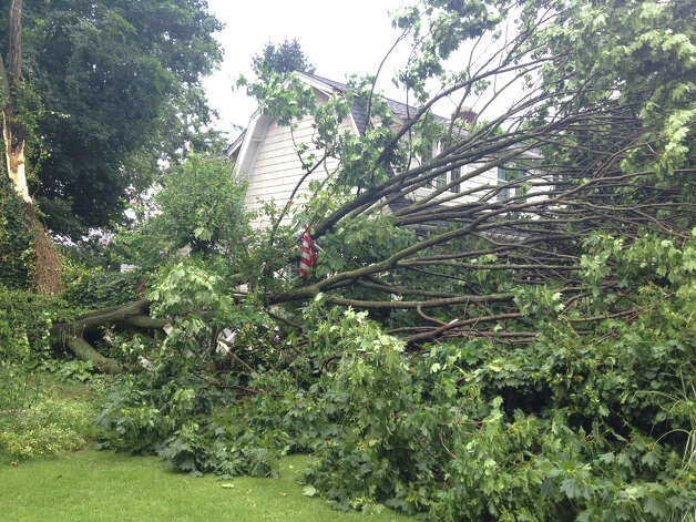 A tree struck a portion of a house at 69 Downs Ave. in Shippan during a fast-moving thunderstorm that moved through the area Wednesday afternoon. Photo: John Nickerson