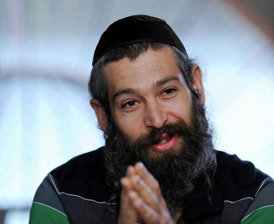 "FILE - This Sept. 3, 2010 file photo shows Hassidic raggae musician Matthew Paul Miller, aka Matisyahu, during an interview in Budapest, Hungary. The 33-year-old Matisyahu is far from the one who lived for years in a modest apartment in Crown Heights, the Orthodox Jewish neighborhood in Brooklyn. He's moved his wife and three sons to Los Angeles, favors pastels over dark suits, ditched the yarmulke, changed his management team, and is self-releasing his music. This month, he releases his fourth studio CD, ""Spark Seeker,"" a fresh sound produced by Kool Kojak with reggae, hip-hop and electronica layered over Middle Eastern instruments and rhythms. (AP Photo/MTI, Zsolt Demecs, file) Photo: Zsolt Demecs"