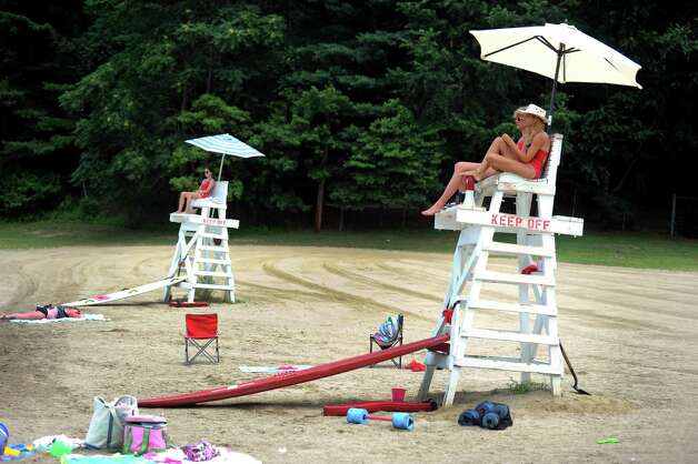 Lifeguards watch over the beach area at Lake Mohegan in Fairfield, Conn. on Wednesday July 18, 2012. The lake is open to swimmers in the designated fenced in area only. 10-year-old Kathleen Trujillo of Bridgeport drown on Tuesday July 17, 2012 while swimming at Lake Mohegan with members of her family in a northern area of the lake where swimming is prohibited, police Chief Gary MacNamara said. Photo: Autumn Driscoll / Connecticut Post