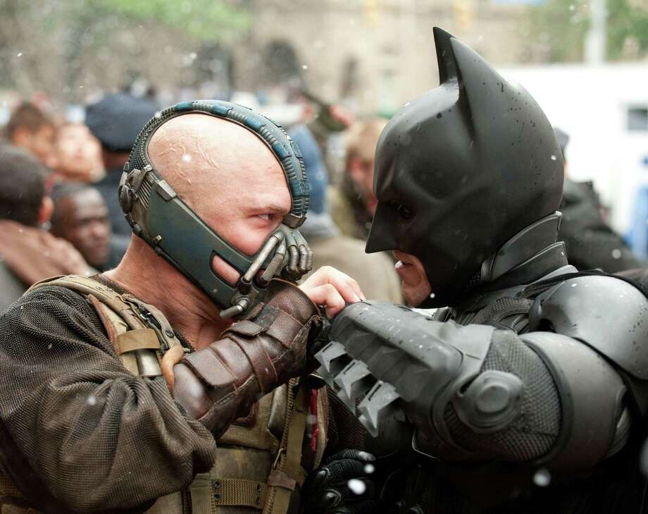 TOM HARDY as Bane and CHRISTIAN BALE as Batman in Warner Bros. TM &  DC Comics. Photo: Ron Phillips, Photographer / © 2012 WARNER BROS. ENTERTAINMENT INC. AND LEGENDARY PICTURES FUNDING, LLC