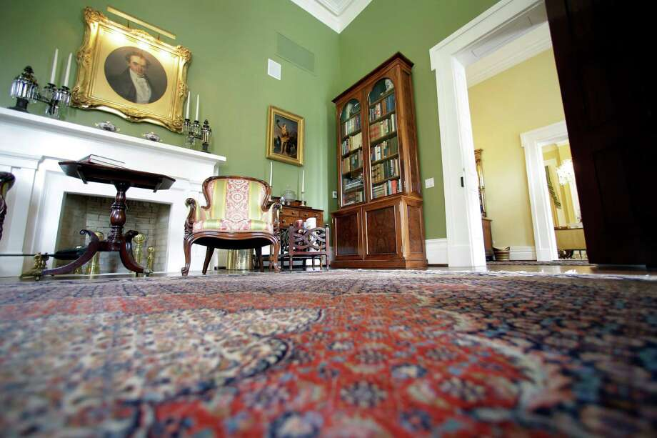 The restored library room is seen in the Texas Governor's Mansion, Wednesday, July 18, 2012, in Austin, Texas. After four years and a $25 million restoration project, the historic Texas Governor's Mansion that was nearly destroyed by fire is complete. (AP Photo/Eric Gay, Pool) Photo: Eric Gay, Associated Press / AP POOL