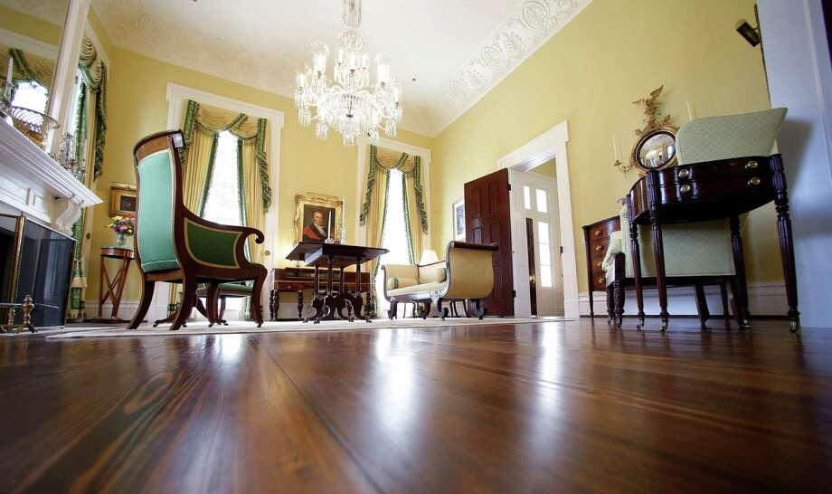 The small parlor is seen in the restored Texas Governor's Mansion Wednesday, July 18, 2012, in Austin, Texas. After four years and a $25 million restoration project, the historic Texas Governor's Mansion that was nearly destroyed by fire is complete. (AP Photo/Eric Gay, Pool) Photo: Eric Gay, Associated Press / AP POOL