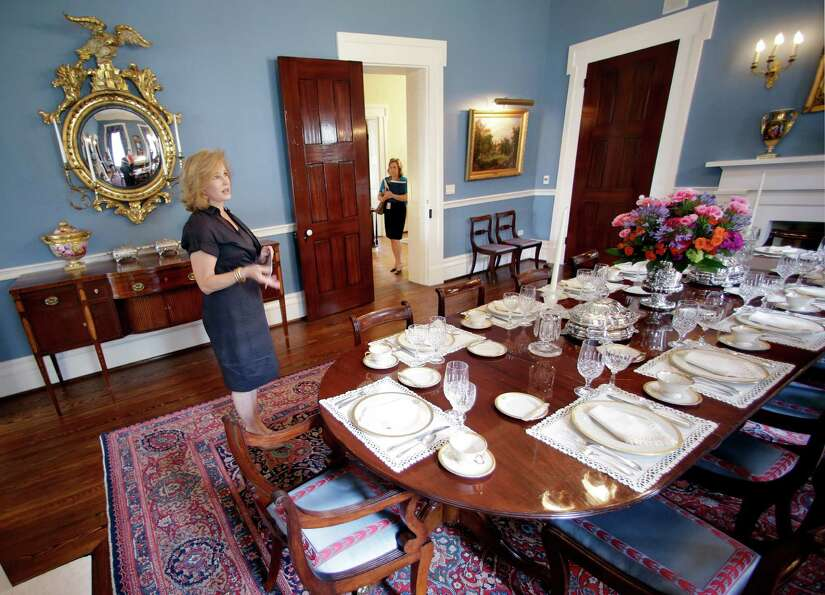 Texas first lady Anita Perry, left, shows the dinning room as she gives a tour of the recently rebui
