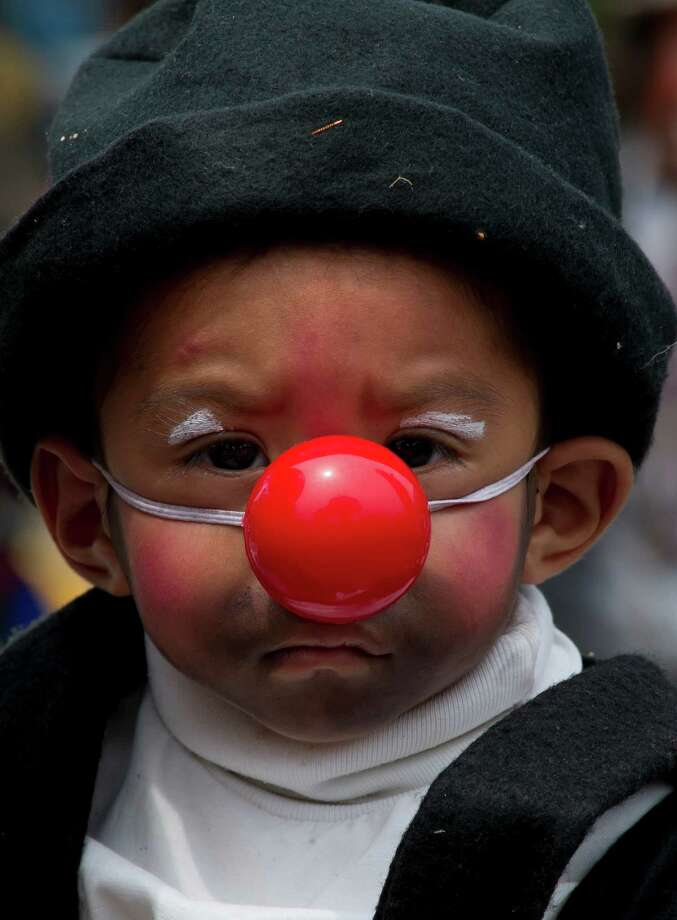 A baby clown poses during a pilgrimage to the Virgin of Guadalupe's basilica, Mexico's patron saint, in Mexico City on July 18, 2012. Hundreds of clowns take part in the annual pilgrimage to the sanctuary of the Virgin. AFP PHOTO/Omar TorresOMAR TORRES/AFP/GettyImages Photo: OMAR TORRES, AFP/Getty Images / AFP