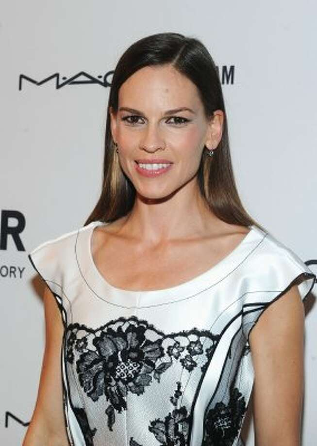 """A relative unknown actress at the time, Hilary Swank transformed into Brandon Teena, a non-operative transgender young man who was beaten, raped and murdered, in the film """"Boys Don't Cry."""" She won an Oscar.  (Jamie McCarthy / Getty Images)"""