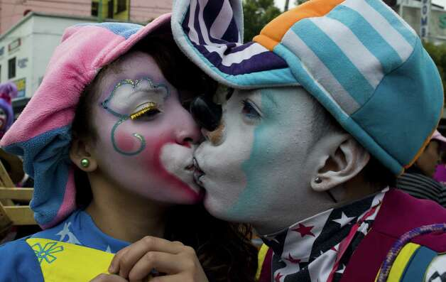 "Clowns ""Coquetin"" (R) and ""Coqueta"" kiss during a pilgrimage to the Virgin of Guadalupe's basilica, Mexico's patron saint, in Mexico City on July 18, 2012. Hundreds of clowns take part in the annual pilgrimage to the sanctuary of the Virgin. AFP PHOTO/Omar TorresOMAR TORRES/AFP/GettyImages Photo: OMAR TORRES, AFP/Getty Images / AFP"