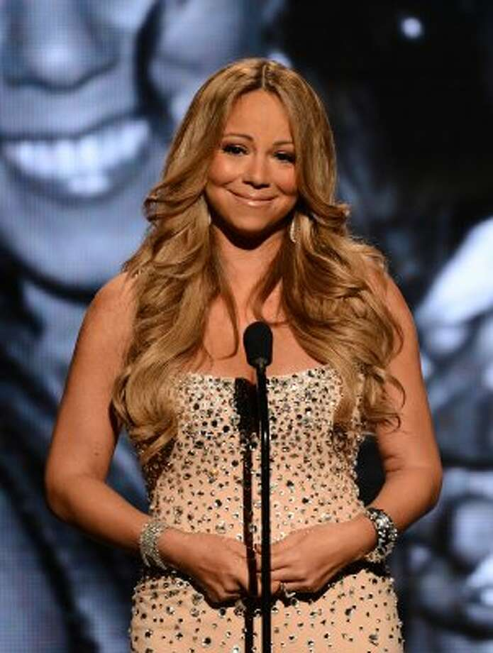 "Singer Mariah Carey is rarely seen sans full makeup, hair and glitter, but for her role in ""Precious: Based on the Novel 'Push' by Sapphire,"" she was decidedly unglam, going without makeup, as well as getting undereye bags and a hint of a mustache.  (Michael Buckner / Getty Images For BET)"