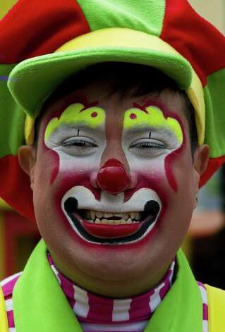 A clown smiles during a pilgrimage to the Virgin of Guadalupe's basilica, Mexico's patron saint, in Mexico City on July 18, 2012. Hundreds of clowns take part in the annual pilgrimage to the sanctuary of the Virgin. AFP PHOTO/Omar TorresOMAR TORRES/AFP/GettyImages Photo: OMAR TORRES, AFP/Getty Images / AFP
