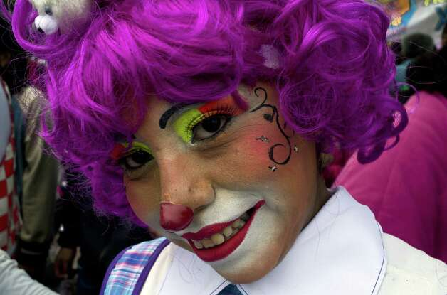 A clown smiles during a pilgrimage to the Virgin of Guadalupe's basilica, Mexico's patron saint, in Mexico City on July 18, 2012. Hundreds of clowns take part in the annual pilgrimage to the sanctuary of the Virgin. AFP PHOTO/Omar TorresOMAR TORRES/AFP/GettyImages Photo: OMAR TORRES, AFP/Getty Images / Omar Torres