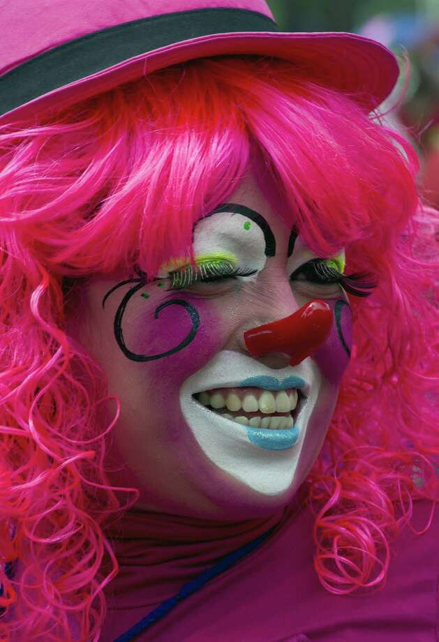 A clown laughs during a pilgrimage to the Virgin of Guadalupe's basilica, Mexico's patron saint, in Mexico City on July 18, 2012. Hundreds of clowns take part in the annual pilgrimage to the sanctuary of the Virgin. AFP PHOTO/Omar TorresOMAR TORRES/AFP/GettyImages Photo: OMAR TORRES, AFP/Getty Images / OMAR TORRES