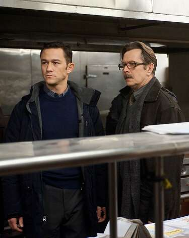 """This undated film image released by Warner Bros. Pictures shows Joseph Gordon-Levitt as John Blake, left, and Gary Oldman as Commissioner Gordon  in a scene from the action thriller """"The Dark Knight Rises."""" (AP Photo/Warner Bros. Pictures, Ron Phillips) Photo: Ron Phillips, Associated Press / SF"""