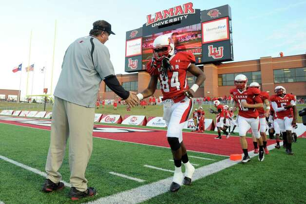Lamar Cardinals head football coach Ray Woodard brings his players onto the field for pre-game warmups before taking on Northwestern State at Provost Umphrey Stadium. Saturday, October 8, 2011.  Valentino Mauricio/The Enterprise Photo: Valentino Mauricio