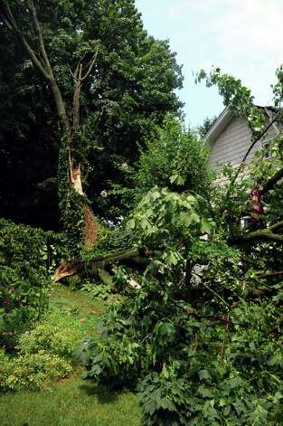 A downed tree and power lines near the intersection of Downs Ave. and Whittaker Street caused minor damage to one house during severe thunderstorms which rolled through Stamford on Wednesday, July 18, 2012. Photo: Lindsay Niegelberg / Stamford Advocate