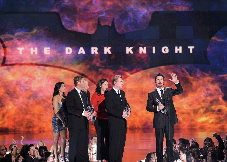 "Aaron Eckhart, producers, director Christopher Nolan and actor Christian Bale accept multiple awards for ""The Dark Knight"", which received critical acclaim.  Photo: Kevork Djansezian, Getty Images For PCA / Getty Images North America"