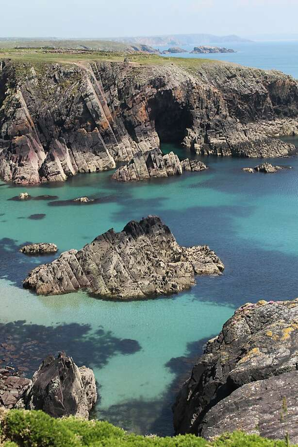 The Pembrokeshire Coastal Path is the best way (and sometimes the only way) to experience the most dramatic portions of Wales' rugged coast, including this portion on St. Non's Bay. Photo: Spud Hilton, The Chronicle