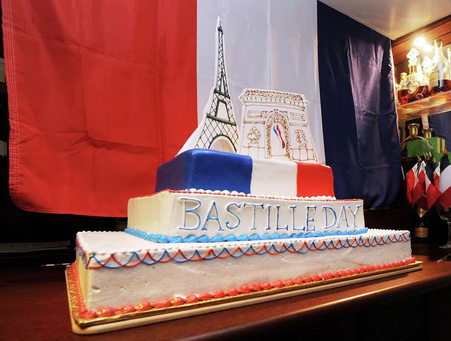 A Bastille Day cake on a table at Restaurant Jean-Louis in Greenwich, Saturday night, July 14, 2012. Restaurant Jean-Louis and the Alliance Française of Greenwich hosted a Bastille Day street paty on Lewis Street. Photo: Bob Luckey / Greenwich Time
