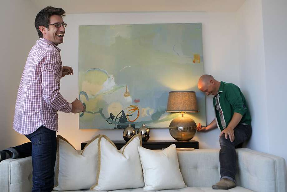 Green Couch Design President Jeff Schlarb (left) and Darren  Ankenbauer stage a $695,000 condo for sale in San Francisco on  Wednesday. Photo: Megan Farmer, The Chronicle