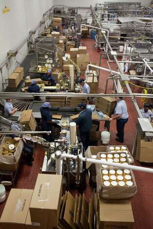 The production floor packages fresh ice cream at Blue Bell Creamery, July 5, 2012 in Brenham, TX. Photo: Eric Kayne / © 2012 Eric Kayne