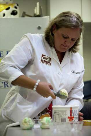 Research and development manager Christy Moran prepares ice cream to be tested at a tasting panel at Blue Bell Creamery, July 5, 2012 in Brenham, TX. Photo: Eric Kayne / © 2012 Eric Kayne