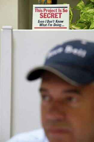 Snack plant manager Jason Jenkins sits before a sign in the test kitchen during a tasting panel at Blue Bell Creamery, July 5, 2012 in Brenham, TX. All the flavors, new and traditional, are tested first in the test kitchen. Photo: Eric Kayne / © 2012 Eric Kayne