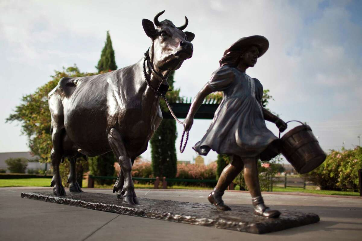 A sculpture of Belle the cow and her keeper stand at Blue Bell Creamery, July 5, 2012 in Brenham, TX.
