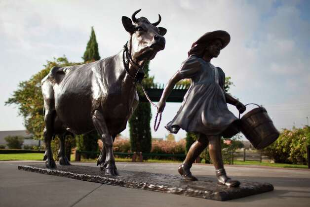 A sculpture of Belle the cow and her keeper stand at Blue Bell Creamery, July 5, 2012 in Brenham, TX. Photo: Eric Kayne / © 2012 Eric Kayne