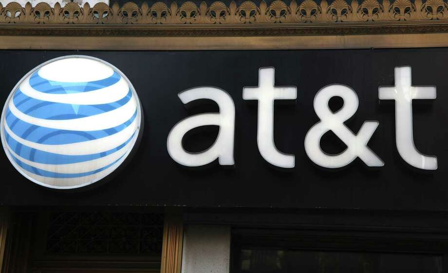 FILE-This May 6, 2012, file photo, shows an AT&T sign at a store in New York. Following in Verizon's footsteps, AT&T said Wednesday, July 18, 2012, it will introduce wireless plans that let subscribers connect up to ten devices. Connected phones get unlimited calling and texting, and all devices get wireless data access. The devices tap into a limited pool of data usage, which get renewed each month.  (AP Photo/CX Matiash, File) Photo: CX Matiash / AP