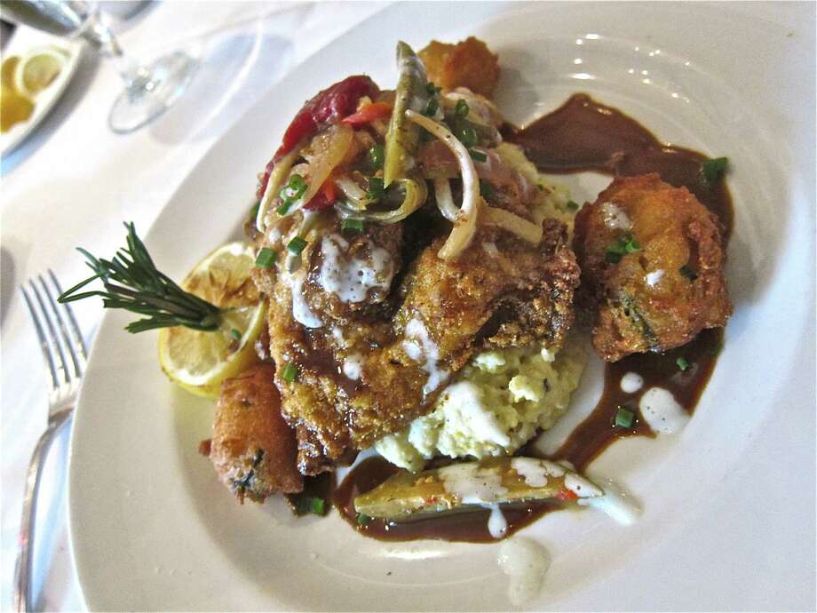 Wild Anahuac catfish with goat cheese grits, hush puppies, okra and Louisiana barbecue sauce Photo: Alison Cook
