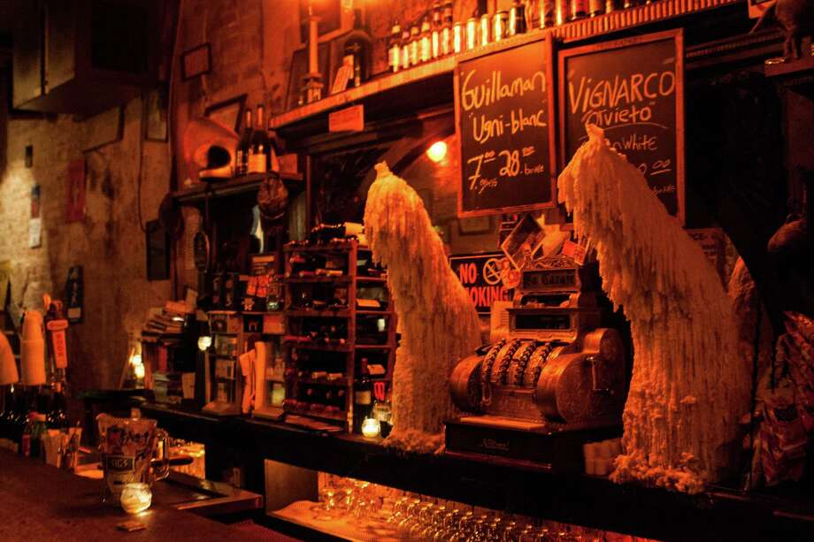 Two massive columns of melted candle wax stand guard behind the bar at La Carafe. Photo: Marc Brubaker / Copyright 2012 by Marc Brubaker.