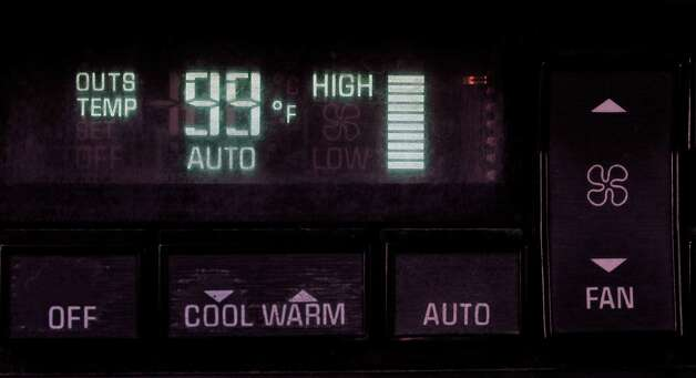 The outside temperature registers 99 degrees on a car dashboard just past noon in Danbury Wednesday July 18, 2012. Photo: Michael Duffy