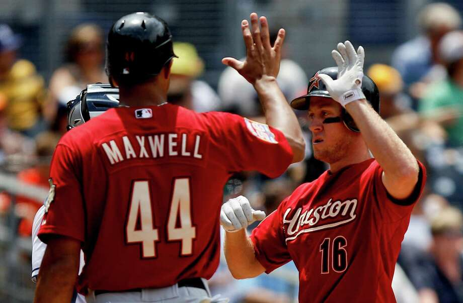 Houston Astros' Matt Downs (16) high-fives with Justin Maxwell after hitting a three-run home run against the San Diego Padres in the sixth inning of a baseball game on Wednesday, July 18, 2012, in San Diego. (AP Photo/Lenny Ignelzi) Photo: Lenny Ignelzi, Associated Press / AP
