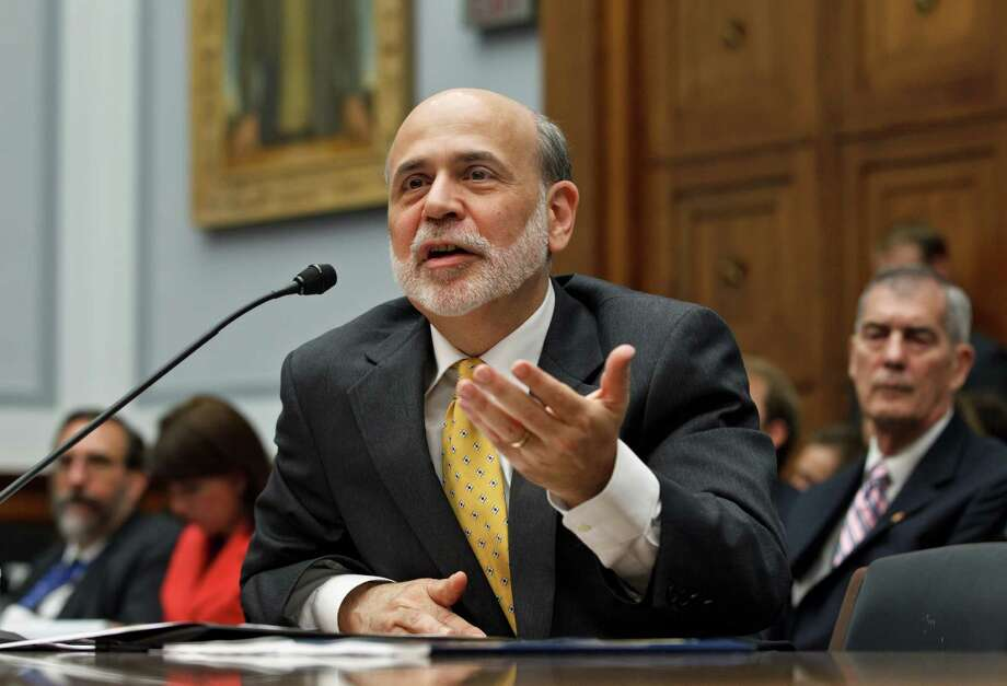 Federal Reserve Chairman Ben Bernanke appears before the House Financial Services Committee to deliver his  twice-a-year report to Congress on the state of the economy, Wednesday, July 18, 2012. Bernanke told lawmakers that the Federal Reserve's efforts to bolster growth have helped lift the U.S. economy out of the recession but he acknowledged that growth remains weak and the Fed can only do so much. Photo: AP