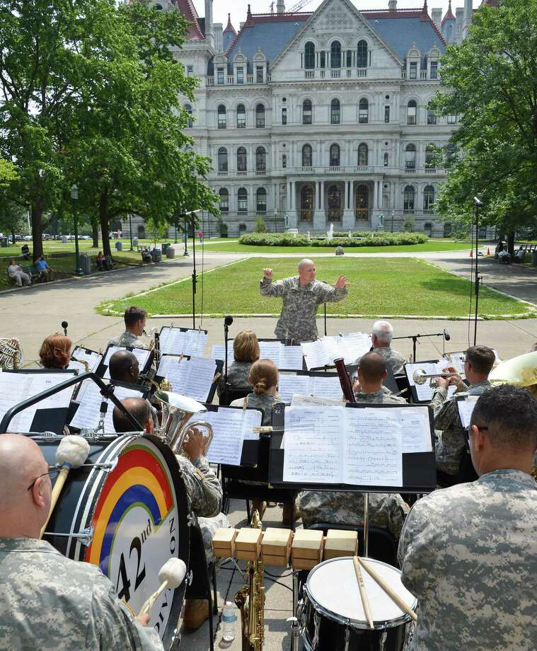 "The 42nd Infantry Division ""Rainbow"" Band of the New York Army National Guard, under the direction of Chief Warrant Officer Mark Kimes, center, performs in West Capitol Park in Albany Wednesday July 18, 2012.   (John Carl D'Annibale / Times Union) Photo: John Carl D'Annibale / 00018359A"